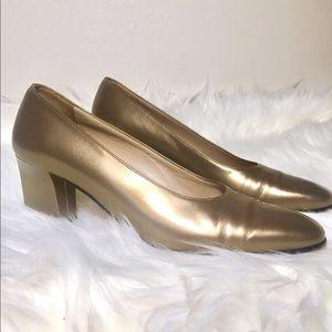 Salvatore Ferragamo golden pumps